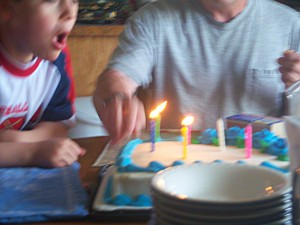 Sam Blowing Out Candles